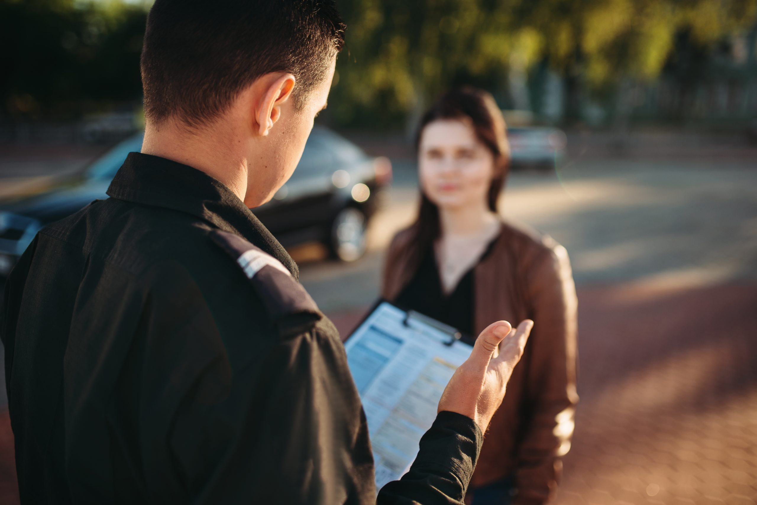 Police officers reads law to female driver